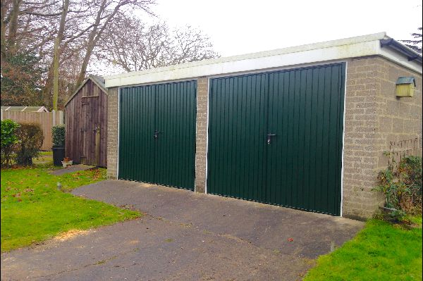 Side-hinged garage doors
